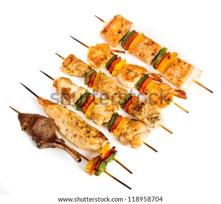 Tasty grilled meat on a white background, shish kebab - stock photo