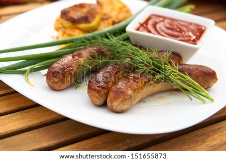 tasty grilled meat sausages on dish