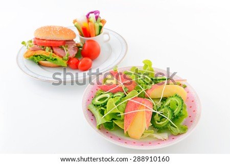 Tasty hamburger with salad