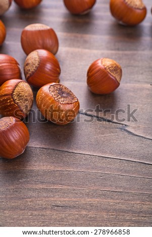 tasty hazelnuts on vintage wooden board food and drink concept  - stock photo
