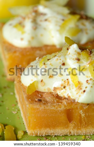 Tasty home-made lemon cake with zest. Shallow depth of field