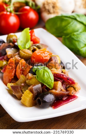 tasty homemade caponata - mixed sweet and sour vegetables  - stock photo