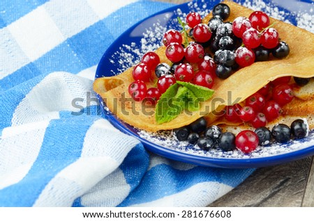 Tasty Homemade crepes with blueberries and Redcurrant