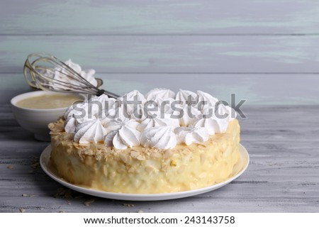Tasty homemade meringue cake on wooden table - stock photo
