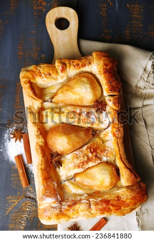 Tasty homemade pear pie on wooden table - stock photo