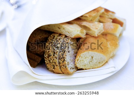 Tasty homemade Sliced bread on plate - stock photo