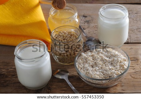 Tasty homemade yogurt with cedar nuts, oatmeal and honey