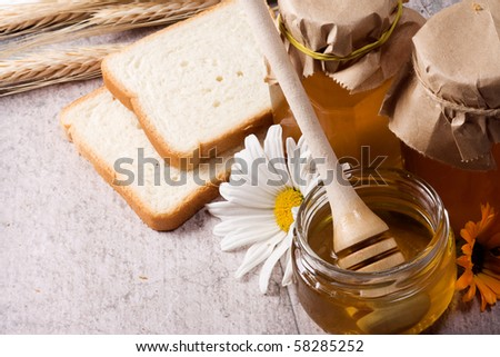 tasty honey and bread on table