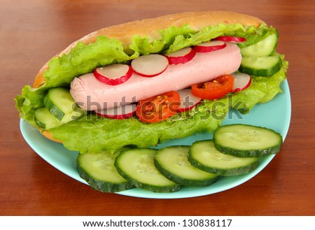 Tasty hot dog on table in cafe