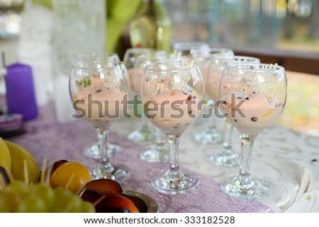 tasty ice cream in glasses on the table - stock photo