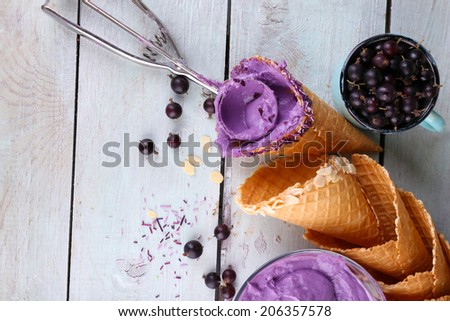 Tasty ice cream with fresh berries on old wooden table - stock photo