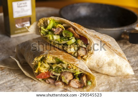 Tasty indian wrap with chicken meat and garam masala spices