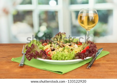 Tasty italian pasta with seafood on bright background