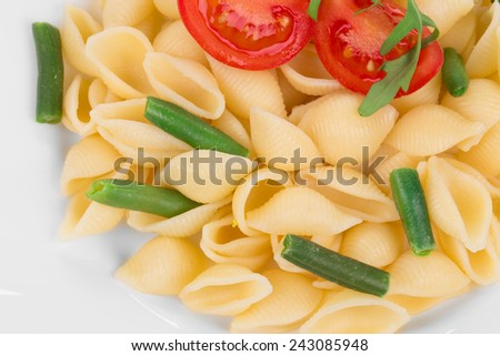 Tasty italian pasta with tomato as haute cuisine. Whole background.