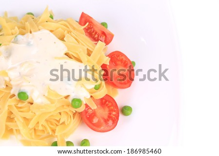 Tasty italian pasta with white sauce. Isolated on a white background. - stock photo