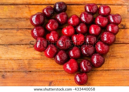 tasty juicy ripe cherries on a wooden background,selective focus - stock photo