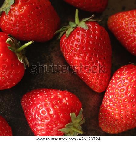 Tasty juicy strawberries macro photo. Red fresh strawberries background. Rich summer strawberry crops, organic farming - stock photo