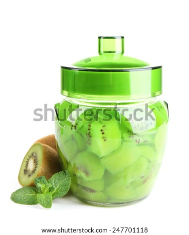 Tasty kiwi jam in glass jar isolated on white