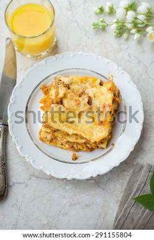 Tasty Lasagna and Orange Juice Homemade Food - stock photo