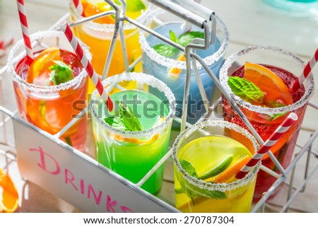 Tasty lemonade with straw and fruits