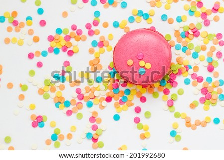 Tasty macaroon against colorful background. Top view - stock photo