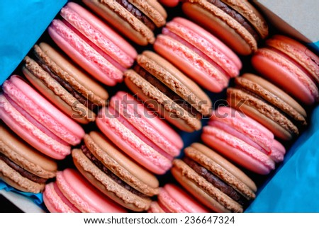 Tasty macaroons in a box - stock photo