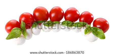 Tasty mozzarella cheese balls with basil and red tomatoes, isolated on white - stock photo