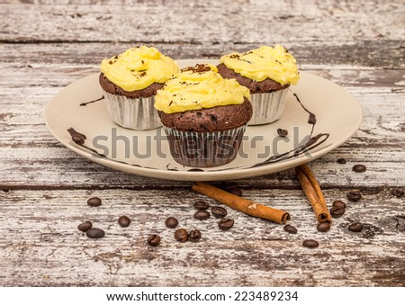 tasty muffin cakes with cacao and coffee seeds  - stock photo