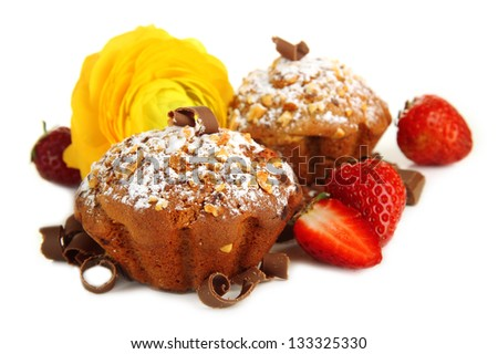Tasty muffin cakes with strawberries and chocolate, isolated on white