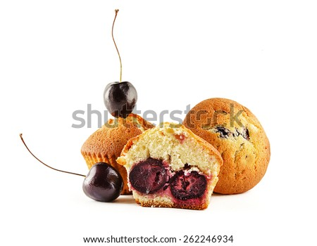 Tasty muffins with cherry on white background - stock photo