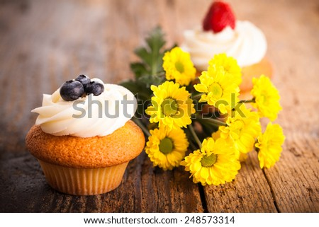 tasty muffins with flower decoration - stock photo