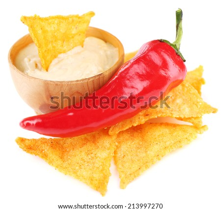 Tasty nachos and bowl with sauce isolated on white