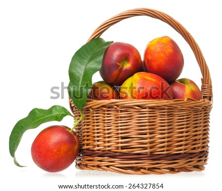 Tasty nectarines in a wicker basket isolated on white background - stock photo