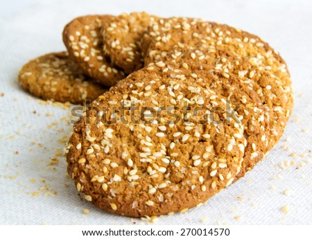 tasty oatmeal cookies with sesame seeds - stock photo