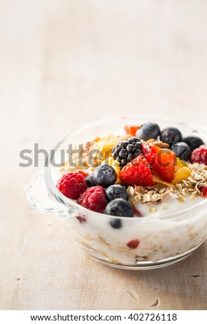 Tasty oatmeal porridge with different berries.