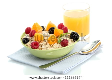 tasty oatmeal with berries and glass of juice, isolated on white