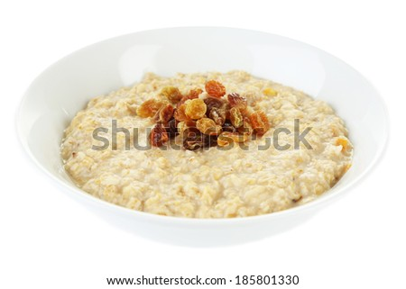 Tasty oatmeal with raisins isolated on white - stock photo