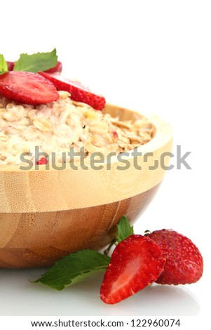 tasty oatmeal with strawberries, isolated on white