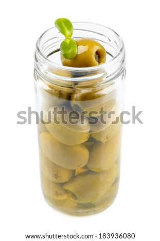 Tasty olives in glass jar, isolated on white