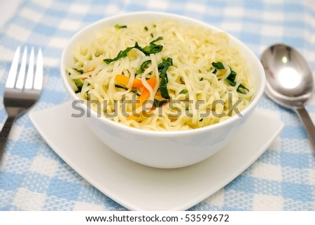 Tasty Oriental style vegetarian yellow noodles with healthy vegetables. Suitable for concepts such as diet and nutrition, healthy lifestyle, and food and beverage. - stock photo