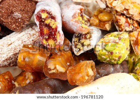 Tasty oriental sweets, on brown background