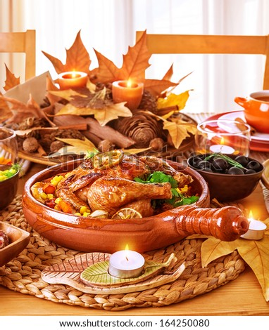 Tasty oven baked chicken on festive served table, Thanksgiving day, traditional autumn holiday, romantic dinner, delicious dish concept - stock photo