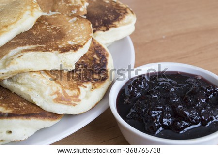 Tasty pancakes on a white plate with jam  - stock photo