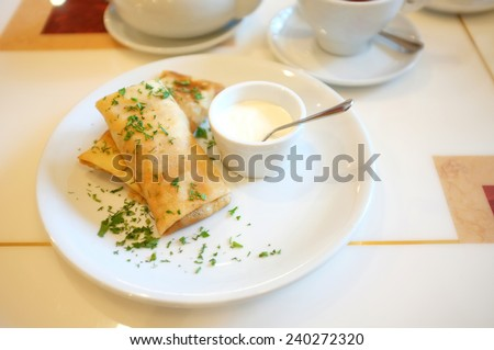 Tasty pancakes on plate in cafe - stock photo