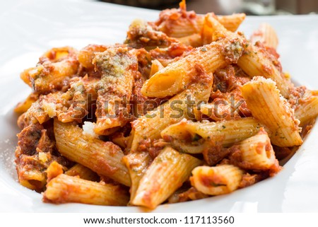 tasty pasta-Italian meat sauce pasta on the table - stock photo