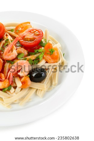 Tasty pasta with shrimps, black olives and tomatoes isolated on white - stock photo