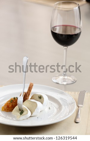 tasty peaces of cheese on white dish with garnish - stock photo