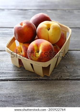 tasty peach in wooden box, food closeup - stock photo