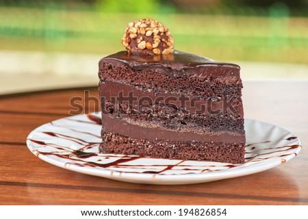 tasty piece of chocolate cake closeup - stock photo