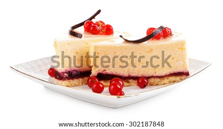 Tasty pieces of cheesecake with berries isolated on white - stock photo